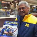 Jim Betts with University of Michigan football gift picture book WOLVERINE: A Photographic History of Michigan Football, Vol. 1