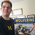 Jon Hein with University of Michigan football gift picture book WOLVERINE: A Photographic History of Michigan Football, Vol. 1
